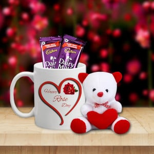 Rose with mug one teddy and two chocolates
