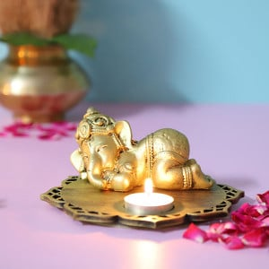 Sleeping Ganesha Idol With Decorative Wooden Base And T Light