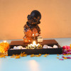 Buddha Monk Sitting With T Light Holder And Pebbles