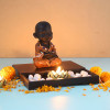 Cute Buddha Monk Sitting With T Light Holder And Pebbles
