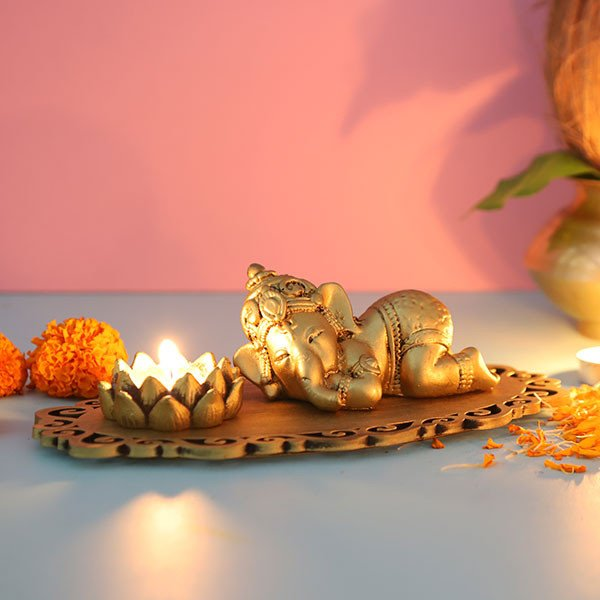 Cute Sleeping Ganesha In A Decorated Tray