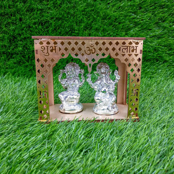 Idols Of Lakshmi Ganesha With Wooden Temple